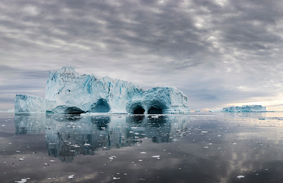 Time and tide do quite a job hollowing out some icebergs