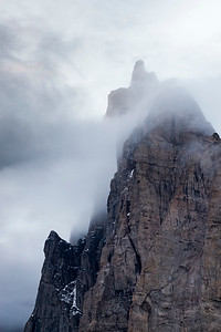 Dramatic clouds suround the peaks on the sides of the Fjord