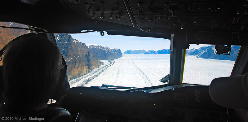 Flying along glaciers in Greenland with a NASA P-3B aircraft.
