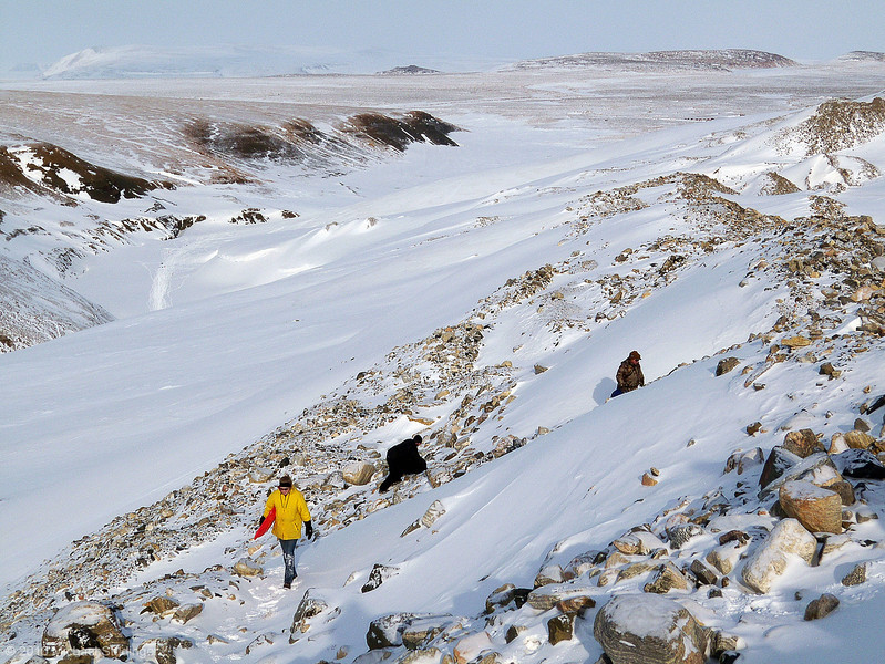 Operation IceBridge team members climb a lateral moraine near Thule on a scheduled crew rest day to experience the Greenland Ice Sheet first hand.