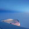Sun rise with moon over the Arctic Ocean during the flight from Palmdale, California, to Thule, Greenland.