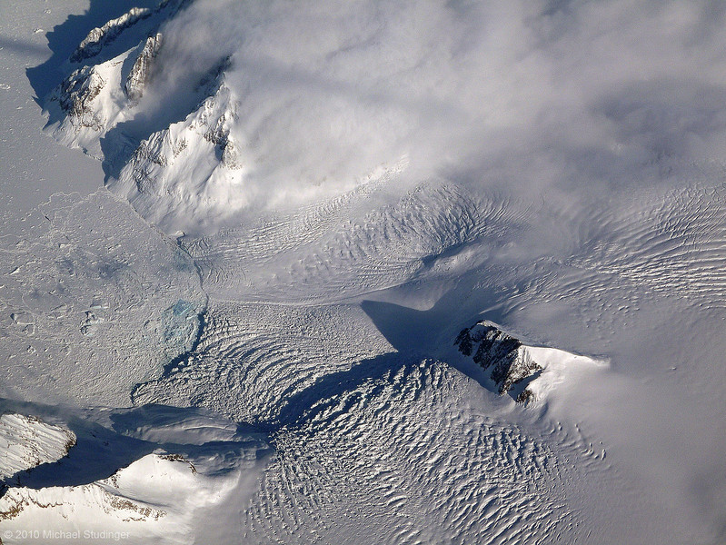 Glaciers and clouds along the spectacular cost of southeast Greenland.
