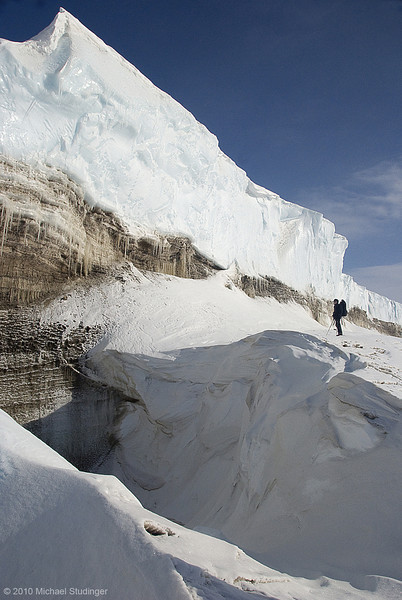 Ice wall near Thule, Greenland. During the Arctic summer, meltwater that forms on the surface of the Greenland Ice Sheet, flows over the cliff and forming a huge water fall.