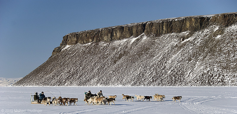 Sled dog race in Thule, Greenland, with Dundas Mountain in the background.