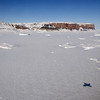 The end of the fjord of Steensby Glacier. Note the shadow of the P-3 on the sea ice in the fjord.
