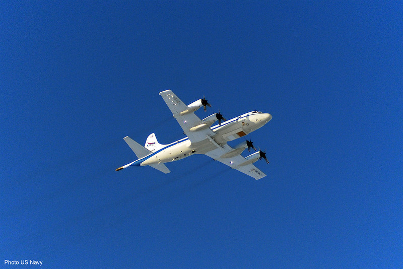 The NASA P-3 surveying over the ICEX camp in the Beaufort Sea. We flew over a survey line in order to calibrate sea ice thickness and snow thickness measurements using ground truth data. Photo courtesy of US Navy.