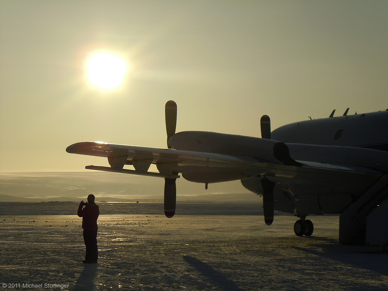 The P-3B getting ready for takeoff on a chilly morning. Land Glacier, which  drains the Greenland Ice Sheet, is within arm's reach of Thule Air Base.