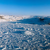 A mixture of bergy bits and sea ice, called mélange, is floating in the Inglefield Bredning near Qaanaaq on the northwest coast of Greenland.