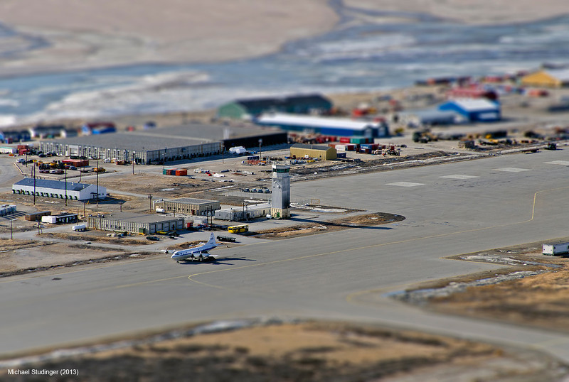 Kangerlussuaq Airport with the NASA P-3B research aircraft and control tower. The view is from Køkkenfjeldet,  also known as Mount Hassell, a 500 meter high ridge north of Kangerlussuaq.