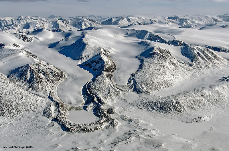 A textbook example of a receding glacier with several terminal and lateral moraines in Thomsen Land, northeast Greenland. You can see a small frozen glacial lake between the moraine and the glacier terminus on the left side.