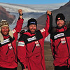 The team poses for a victory shot in the midnight sun at the head of McCormack fiord and the journey.
