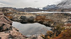 Small reflecting pool on NE Milne Land overlooking O Fjord and Renland, Scoresby Sund, Greenland
