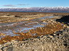 Small stream near Nerlerit Inaat airport with Hurry Inlet and the mountains of Liverpool Land in the background, East Greenland