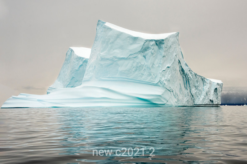 Iceberg with rippled reflections