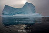 Iceberg with sun and reflection md