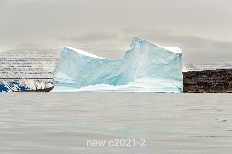 Iceberg in front of Gasepynt and Geikie Plateau, near Denmark Island, East Greenland