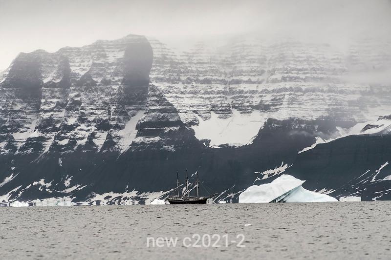 Rembrandt van Rijn schooner off Geikie Plateau with icebergs, Scoresby Sund, Greenland