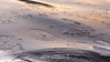 Sea ice in a rolling sea at sunrise, Rodefjord, Scoresby Sund, East Greenland