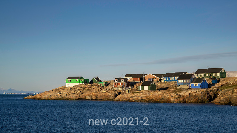 Houses with distant icebergs