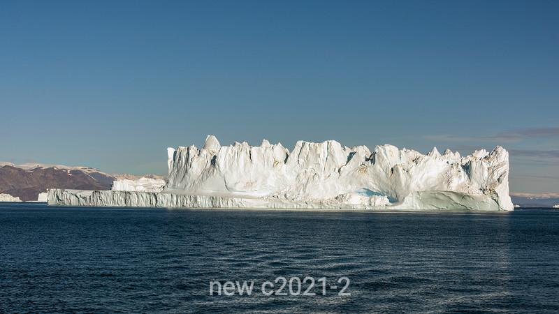 Large iceberg with sculptured top off Jameson Land, Hall Breding, Scoresby Sund, Greenland