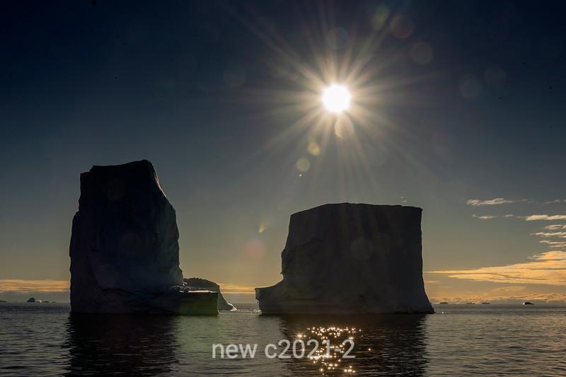 Icebergs with sunburst