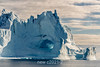 Old blue iceberg with cave, Hall Bredning, Scoresby Sund, Greenland