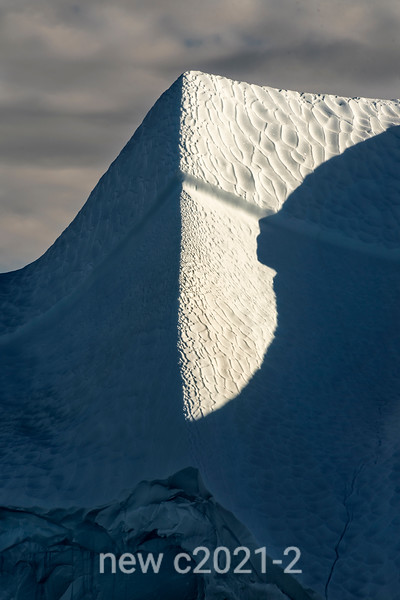 Iceberg with shadow face