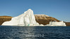 Large sculptured iceberg offshore in Hall Breding, Scoresby Sund, Greenland