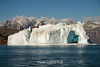 Ssee though ice cave in old iceberg off Jameson Land, Hall Breding, Scoresby Sund, Greenland