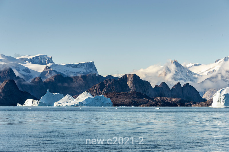 Icebergs and igneous rock bornhardts, Jameson Land, Scoresby Sund, Greenland