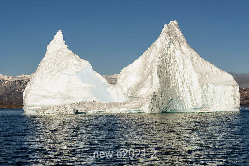 Eroroded iceberg in Hall Bredning near Jameson Land, Scoresby Sund, Greenland