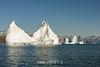 Large icebergs disintegrating in Hall Bredning, Scoresby Sund, Greenland