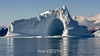 Iceberg with large cave, Hall Bredning, Scoresby Sund, Greenland