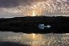 Reflected sun pillar and bergy bit at sunset, Bjorn Islands, Hall Bredning, Scoresby Sund, Greenland