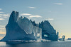 Late day blue iceberg with cave, Hall Bredning, Scoresby Sund, Greenland sm