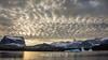 Bjorn Islands with Renland and Grundtvigskirken peak in the background, Scoresby Sund, Greenland