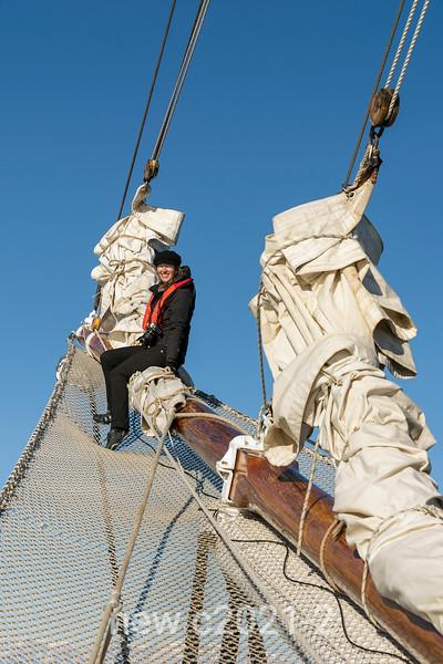 Photographer on the bowsprit of Rembrandt van Rijn, Hall Bredning, Scoresby Sund, Greenland