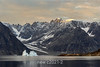 Glacial valley and icebergs at sunset, Milne Land with Bjorne Island in the foreground, Scorebsy Sund, Greenland