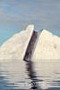 Iceberg with dark line of medial moraine, Rypefjord, Scoresby Sund, East Greenland
