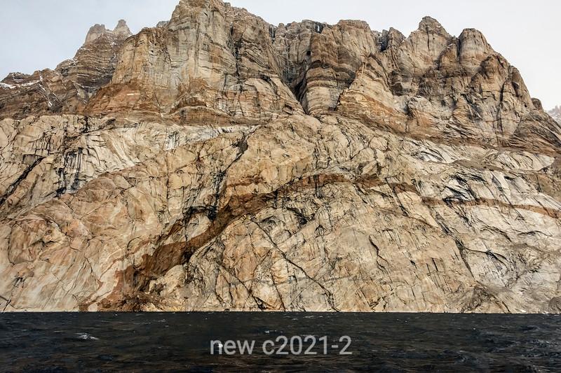 Steep granite cliff with striations, Ofjord, Scoresby Sund, Greenland