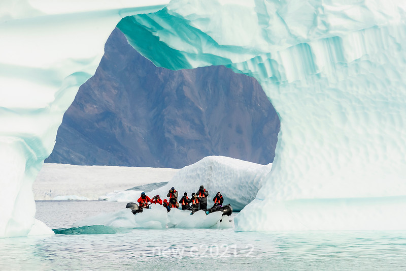 Paparazzi shooting through an ice arch, Rypefjord, Scoresby Sund, Greenland