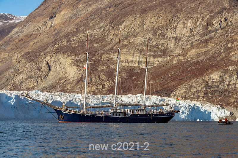 Rembrandt van Rijn anchored by the toe of the Rolidge Brae Glacier with zodiac, Rodefjord, Socesby Sund, Greenland