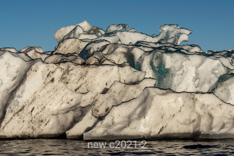 Black-rimmed iceberg close-up, Rodefjord, Scoresby Sund, East Greenland