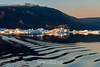 Ripples, reflections and icebergs at sunset, Rodefjord, Scoresby Sund, East Greenland
