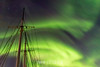 Ship's masts with northern lights, Rodefjord, Scoresby Sund, East Greenland