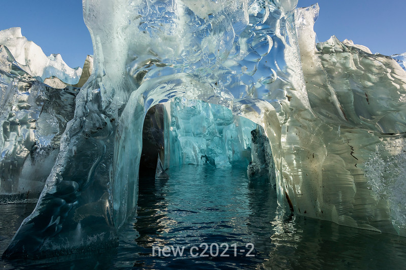 Looking into an ice cave in an old crystalling blue iceberg, Rodefjord, Scorseby Sund, East Greenland