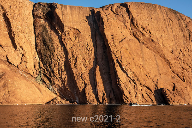 Zodiac by the cliffs of Rode O, Rodefjord, Scoresby Sund, Greenland