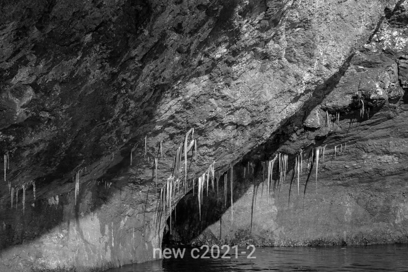 Sandstone conglomerate overhang with icicles, Rode O, Rodefjord, Scoresby Sund, Greenland