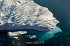 Iceberg with underwater ice shelf and floating bits of ice, Rodefjord, Scoresby Sund, Greenland