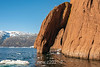 Sandstone arch with gull, icebergs and zodiac, Renodde in BG, Rode O, Rodefjord, Scoresby Sund, Greenland